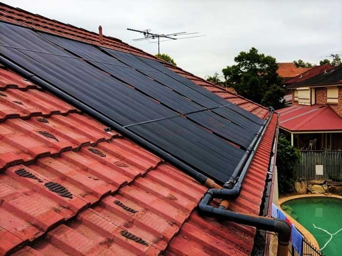 spanish tiled roof with solar panels for pool