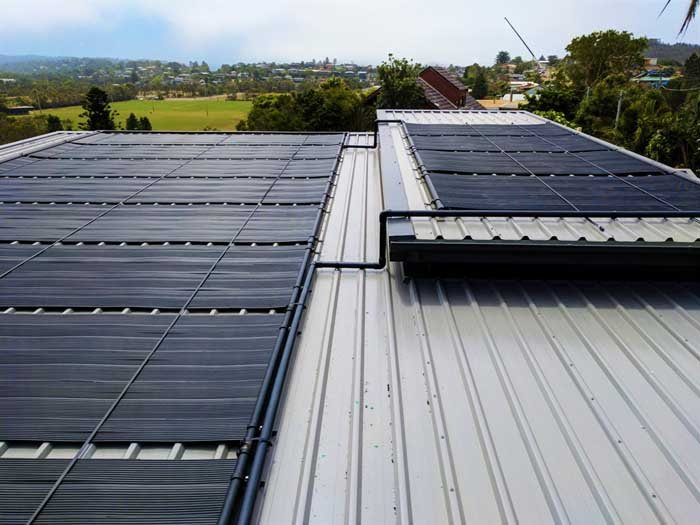 industrial roof with several solar panels