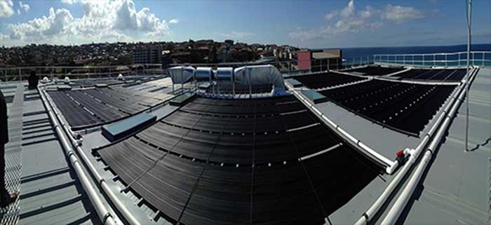 panorama of commercial solar panels for pools