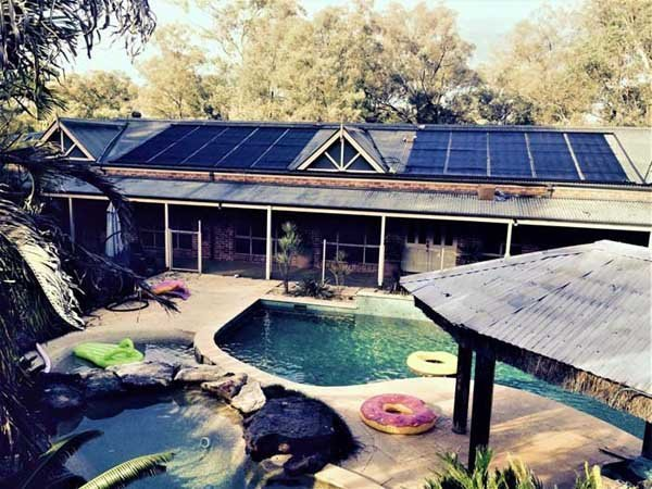 house with solar powered pool