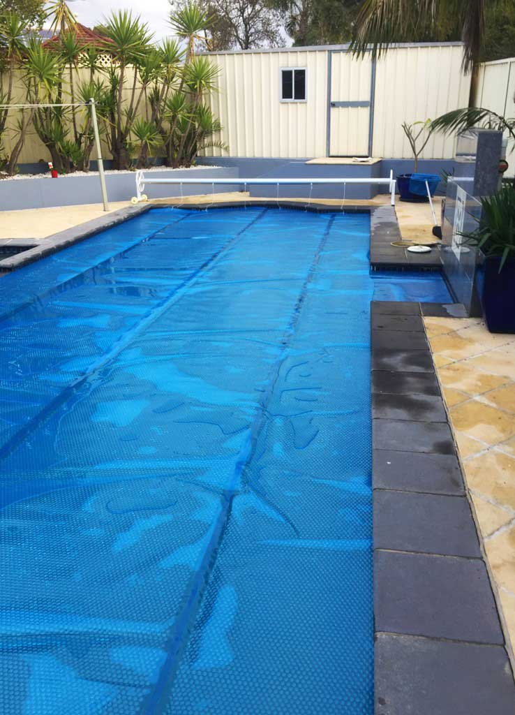 heated pool with blue cover
