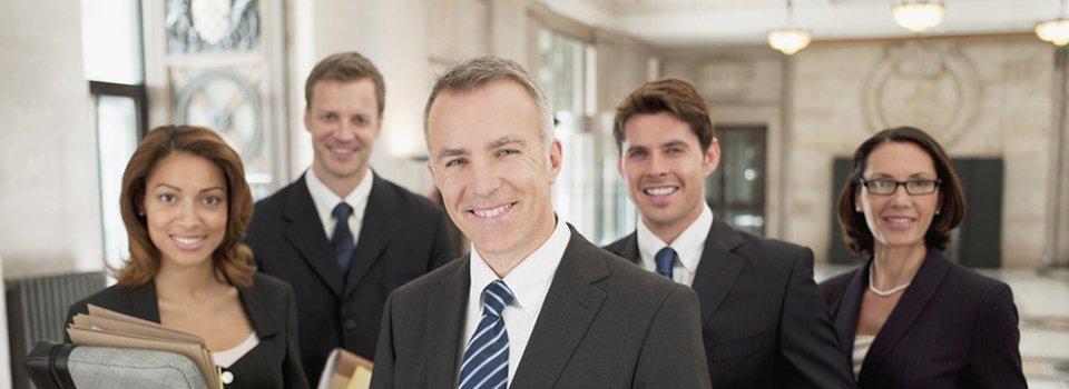 A smiling legal team
