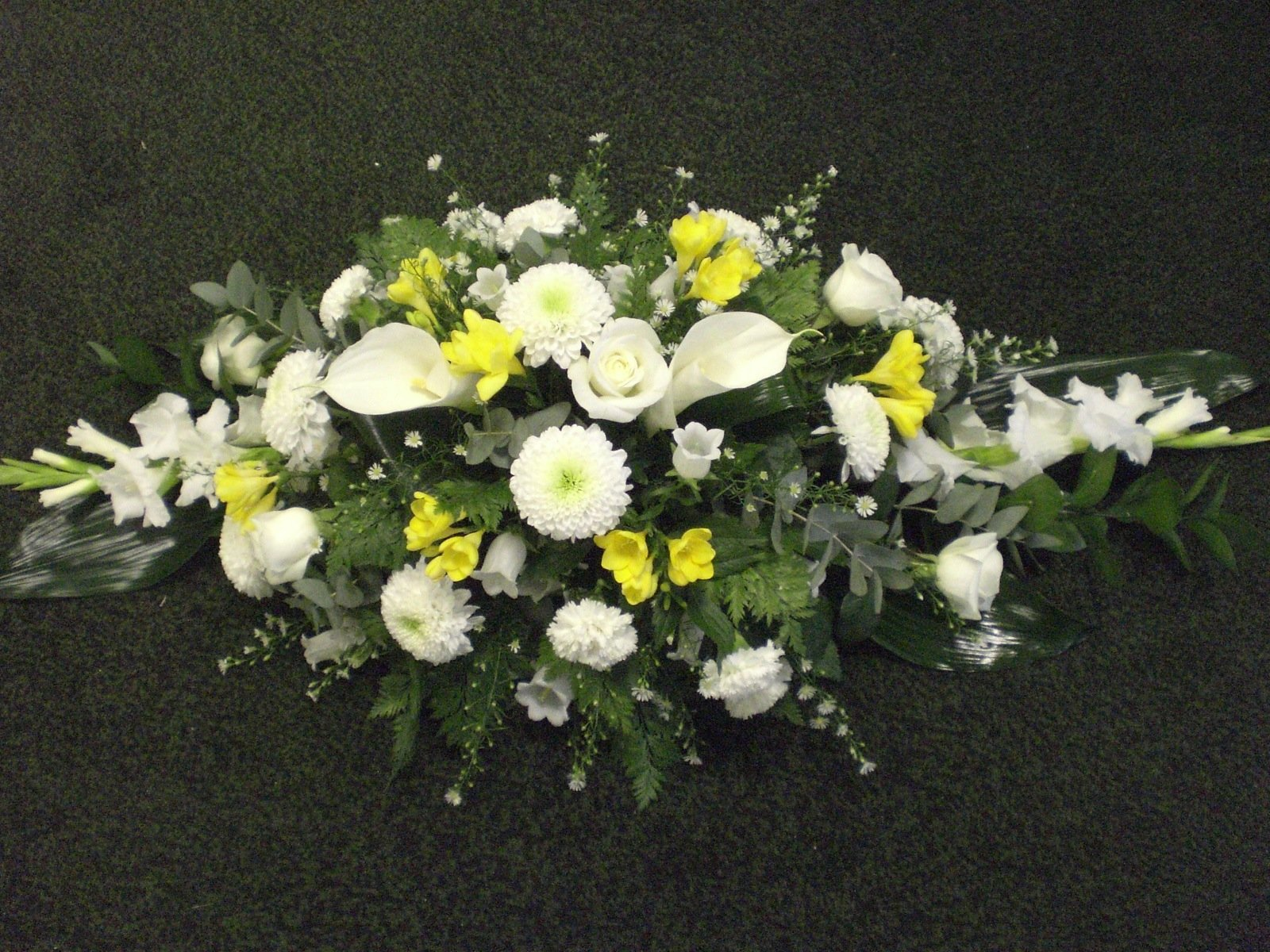 yellow and white flower casket