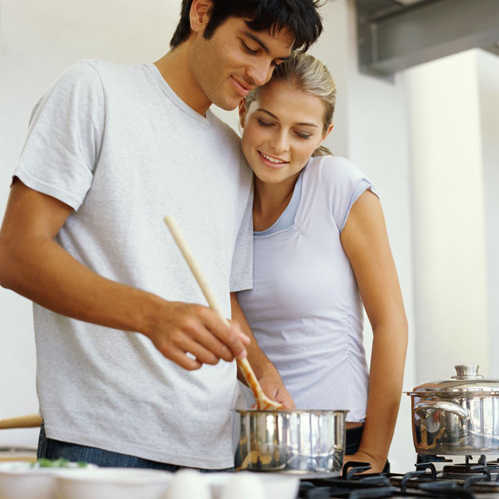 Couple cooking on a stove installed by propane experts in Ashland, NE