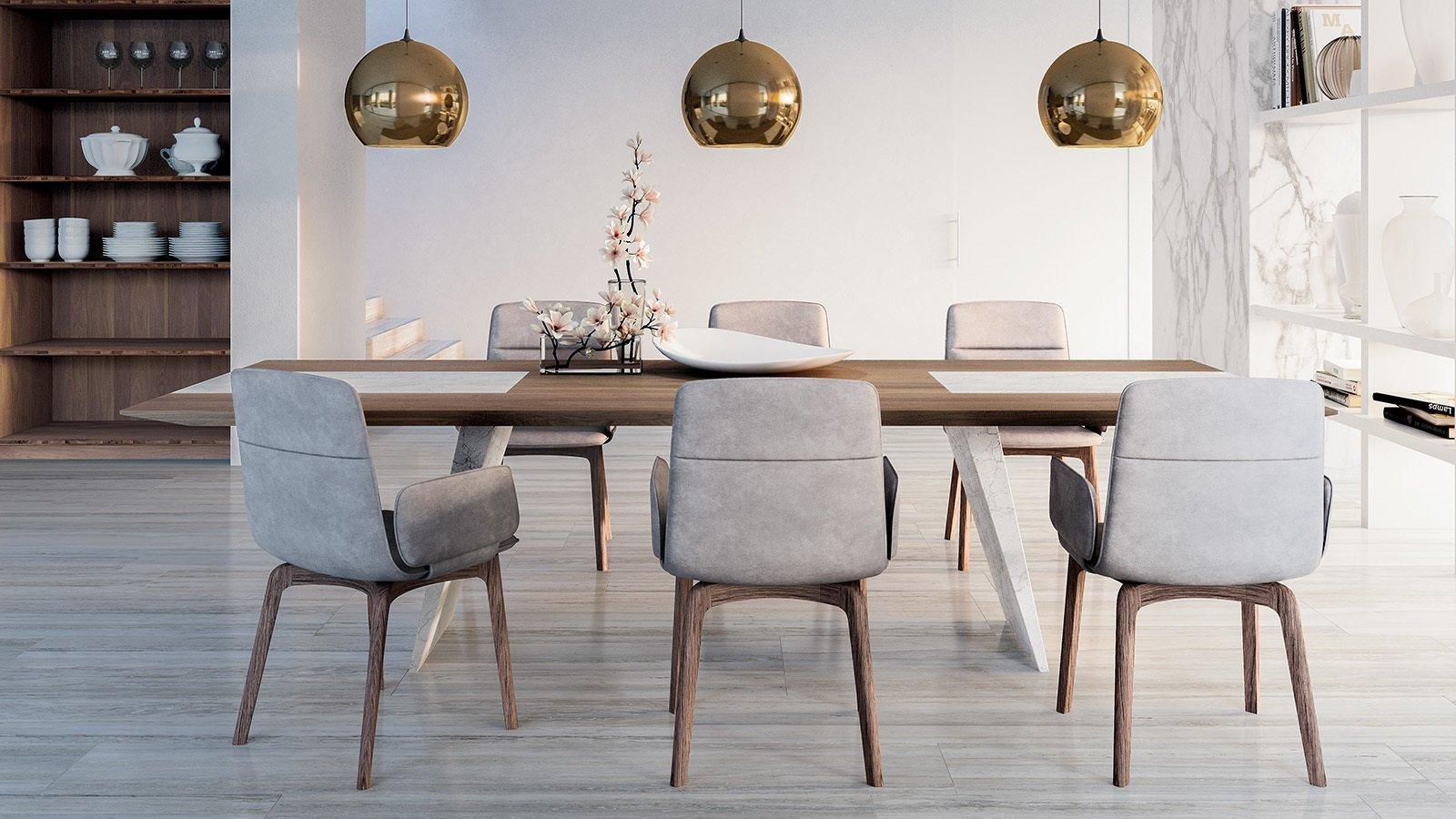 un tavolo in legno con delle sedie e delle lampade a sospensione dorate