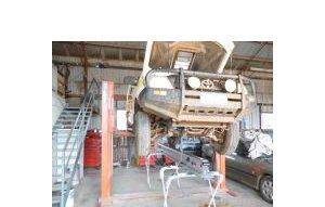 herks panel repairs car hanging