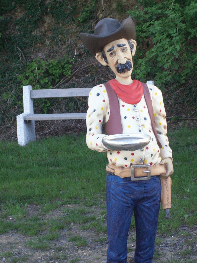 Cowboy con una pepita gigante d'oro