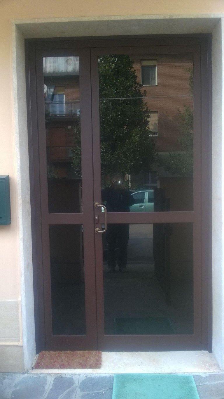 Porte a vetro condominiali modena fb di bizzarri franco - Porte ingresso vetro ...