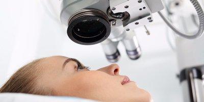 Woman with a lazer surgery machine