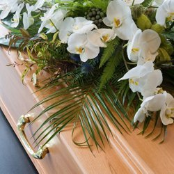 White flowers on a coffin