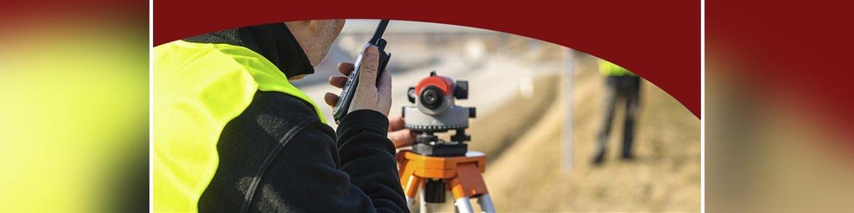 vince morgan surveyors pty ltd man with surveyors equipment.