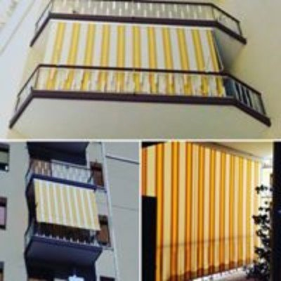 delle tende verticali gialle e arancioni su dei balconi