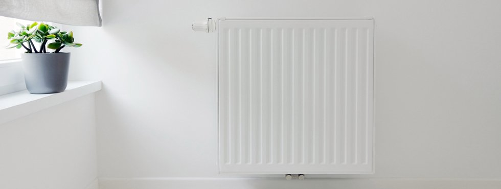 A white radiator mounted on a wall