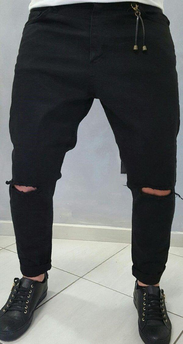 Pantalone in cotone con strappi