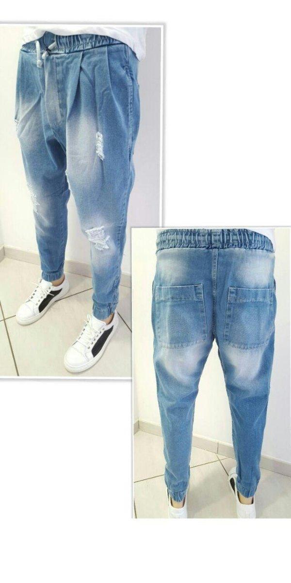 Jeans semiturco con molla e zip alla caviglia