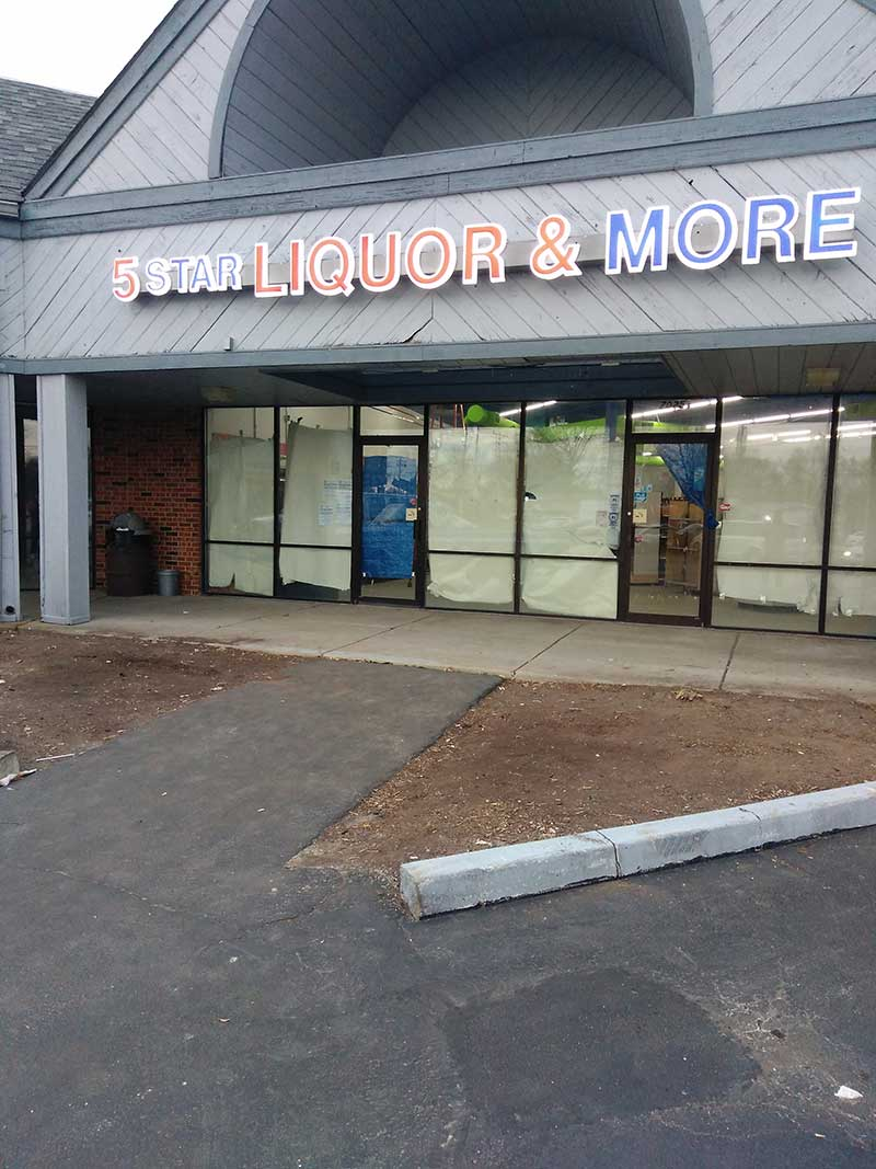 Liquor and more commercial sign