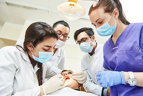 Team of professionals checking the patient  teeth