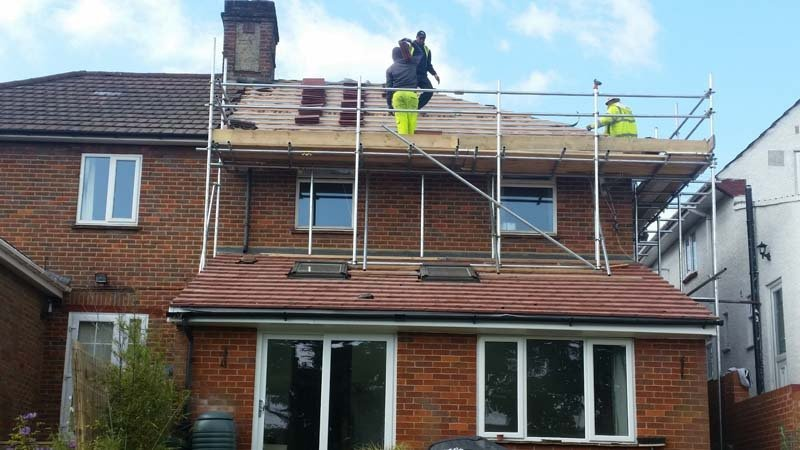Roofers up on a roof