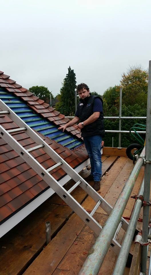 A roofer working hard