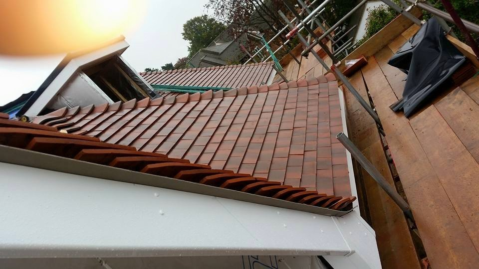 New roofing tiles being fitted