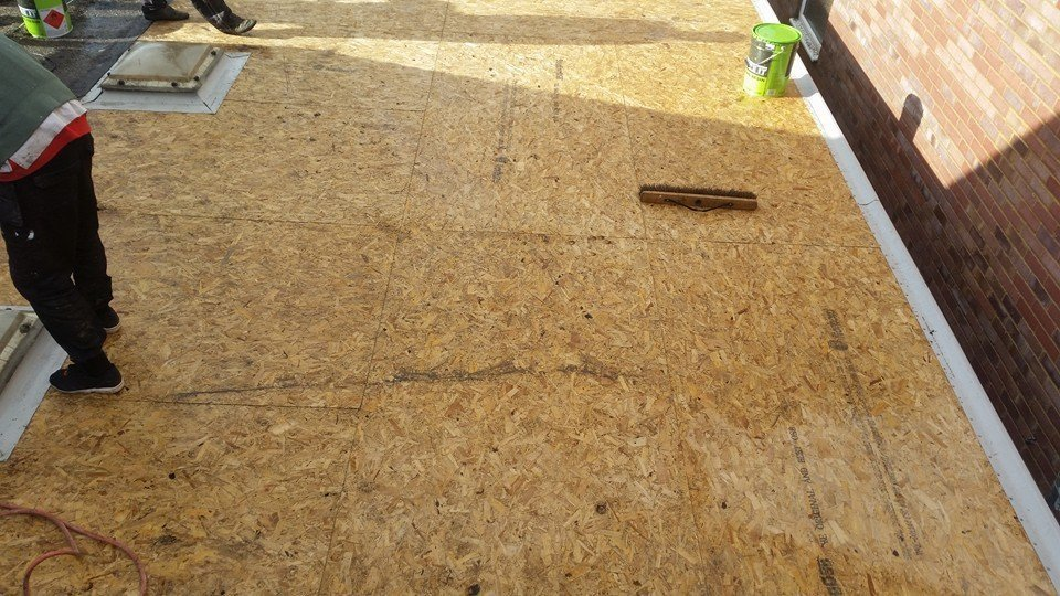 A flat roofing project in progress