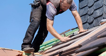 A roofer at work