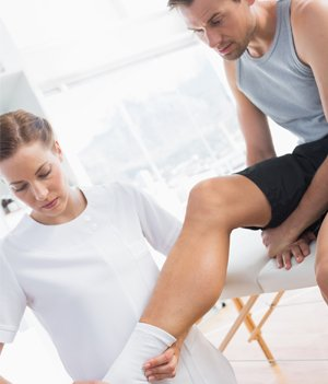 action physiotherapy leg of man with bandage