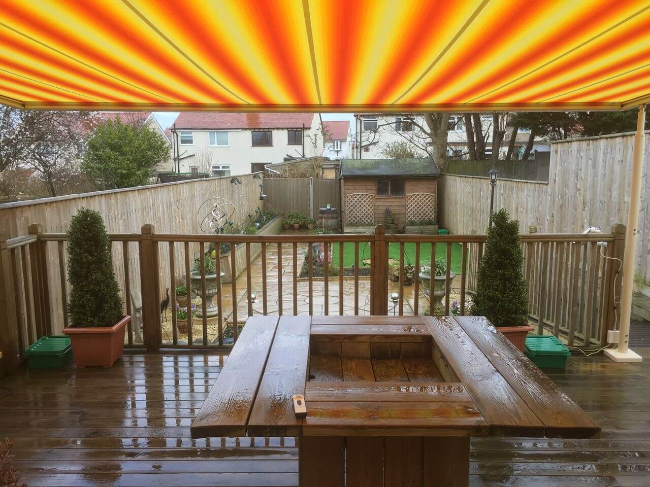 Markilux pergola over timber decking and patio