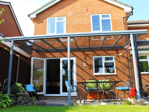 Glass veranda over patio in Yorkshire with garden