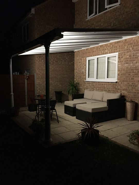 Glass veranda with led lighting over patio in Yorkshire with garden