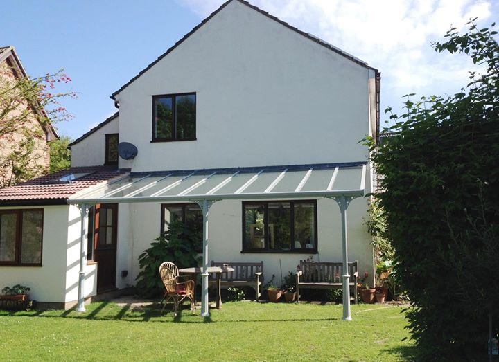 Victoria Glass veranda over patio in Yorkshire with garden