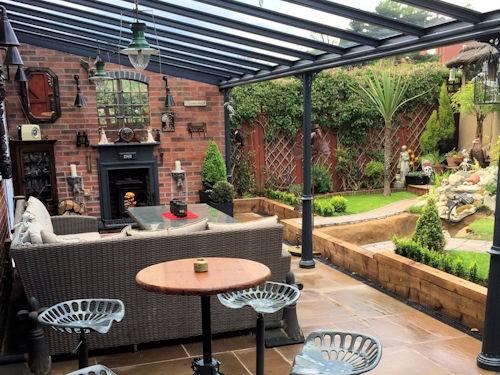 Victorian Glass veranda over patio in Yorkshire with garden