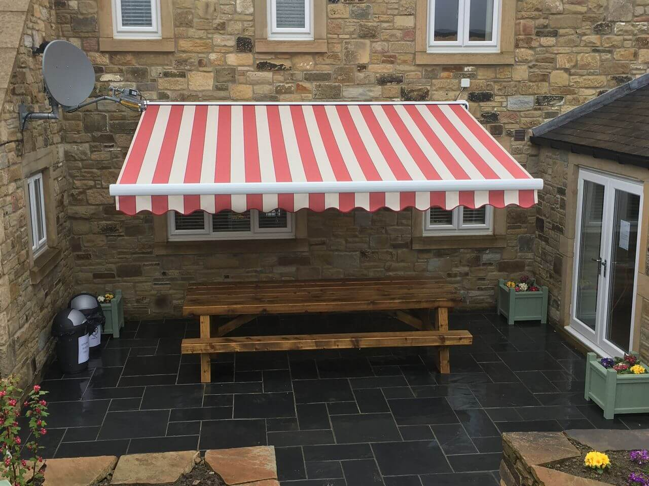 Electric patio awning over a slate floor