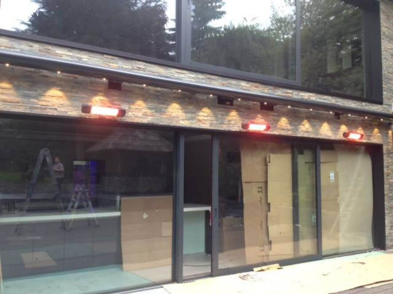 Weinor opal design awning with LED lighting over bifold doors and patio