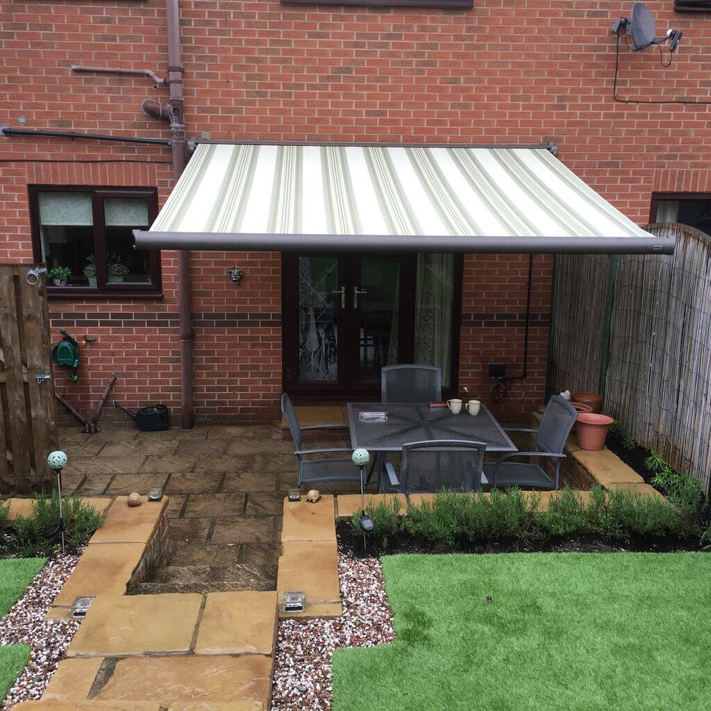Weinor cassita II electric awning over french doors and patio with garden furniture