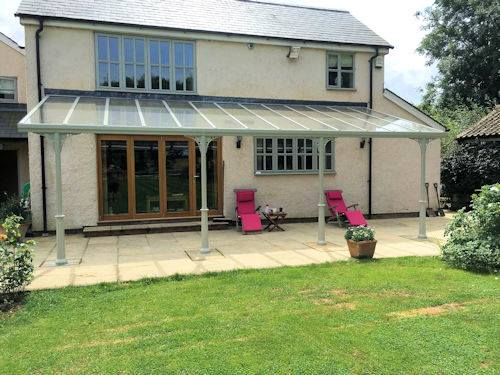 Glass veranda in Yorkshire over a patio and garden