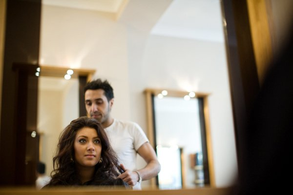 client checking hair in mirror