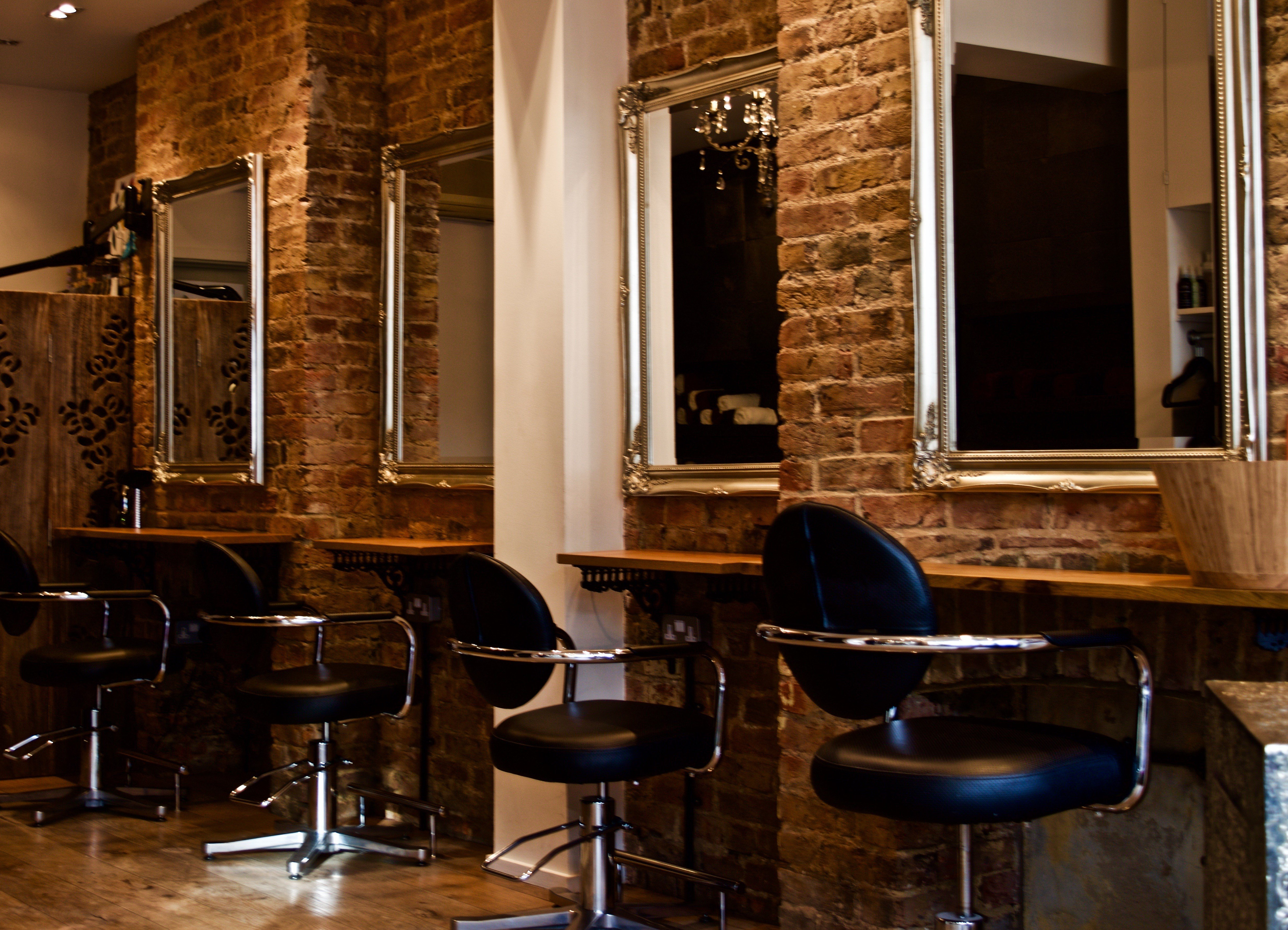 our teddington salon with bare brick walls