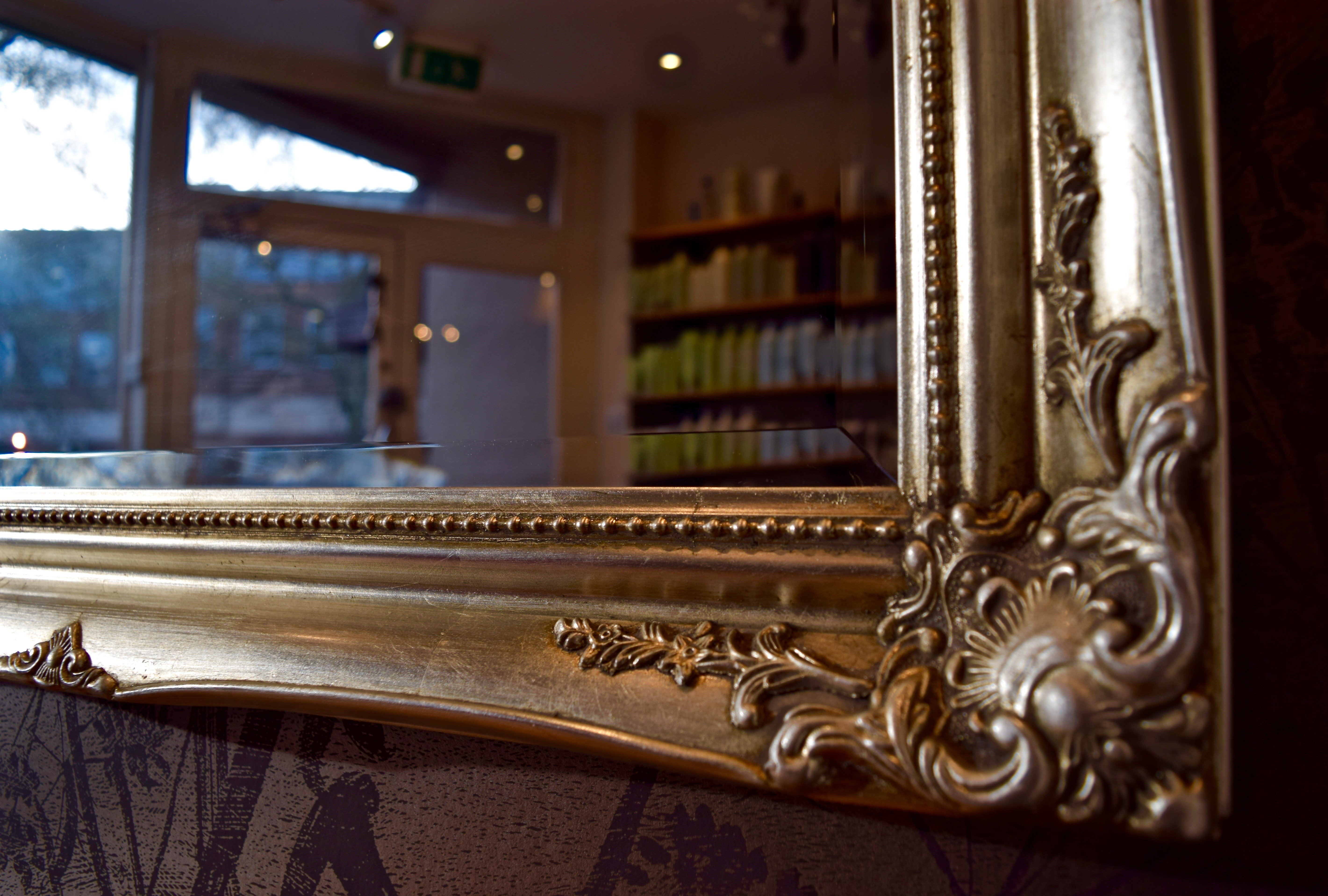 large mirror in ornate carved frame