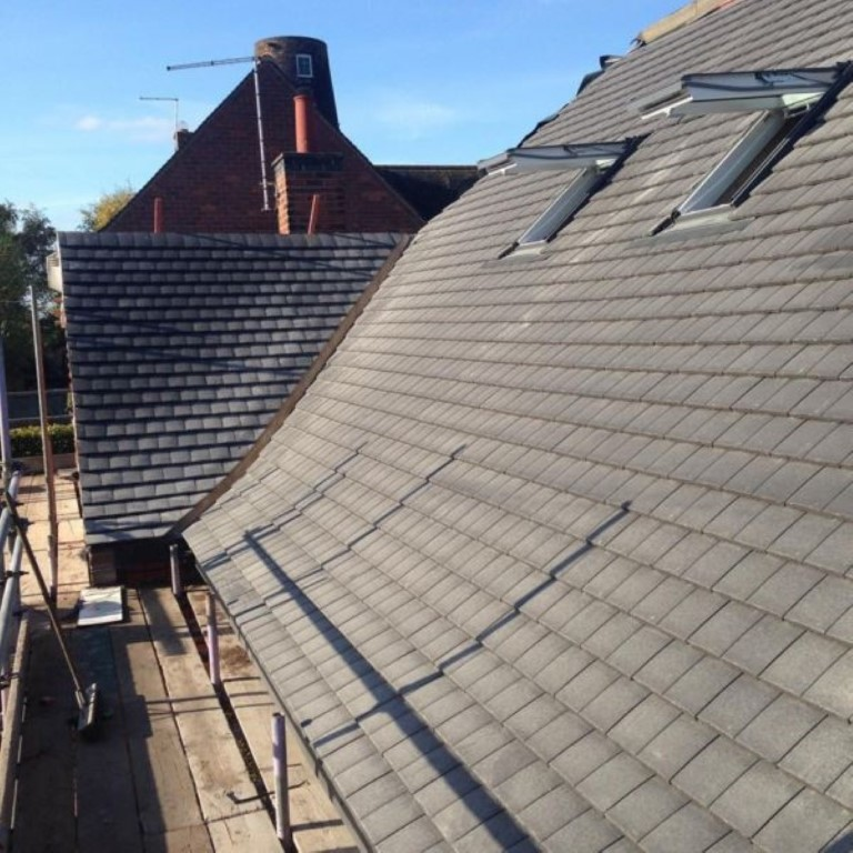 before and after slate roof cleaning