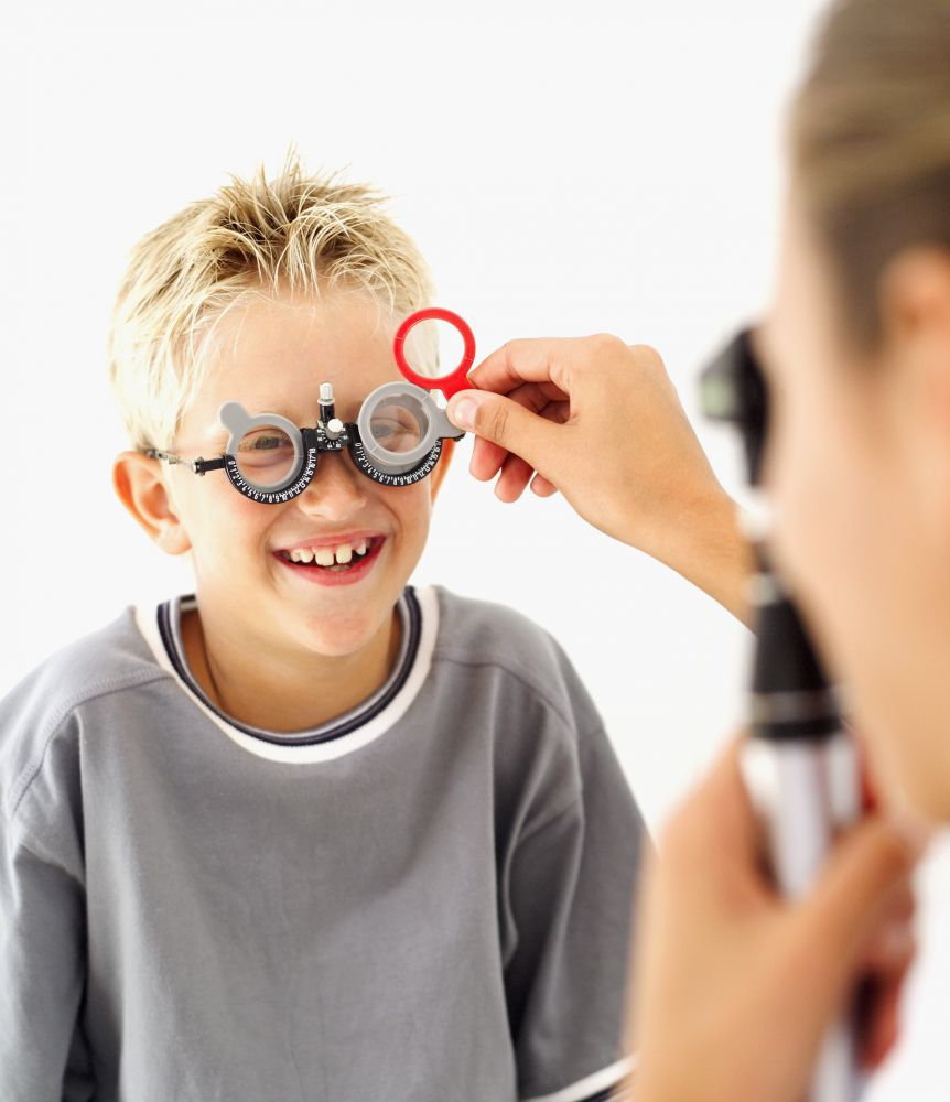 An optometrist performs an eye exam on a child in Russellville, AR