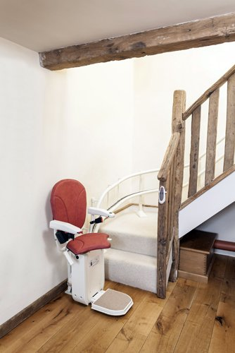 View of red colour stairlifts offered by Anglia Stairlifts