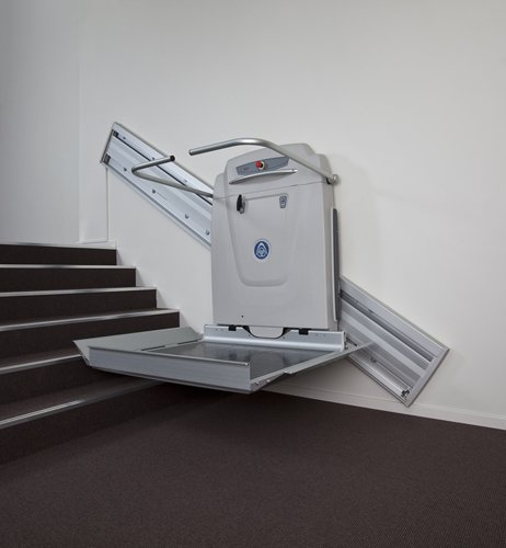View of installed step lift offered by Anglia Stairlifts
