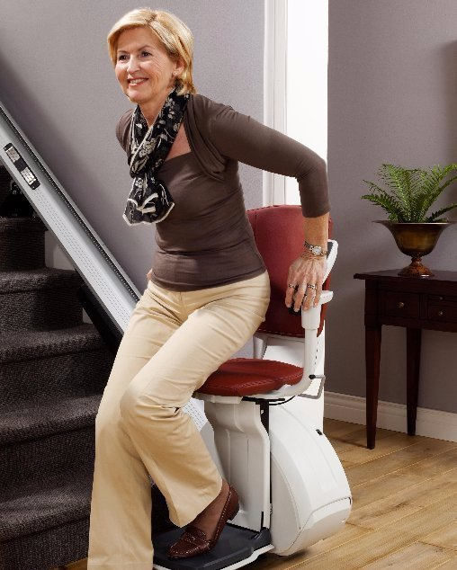 Women sitting on a Home Glide stair lift chair