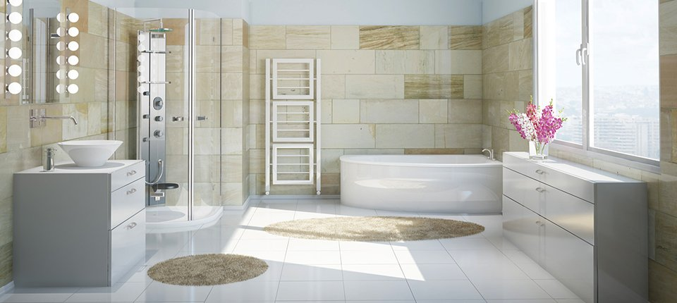 A large bathroom with white corner bath, washbasin and tiled floor, a shower stall, a white chest of drawers, and cream marble effect tiled walls,