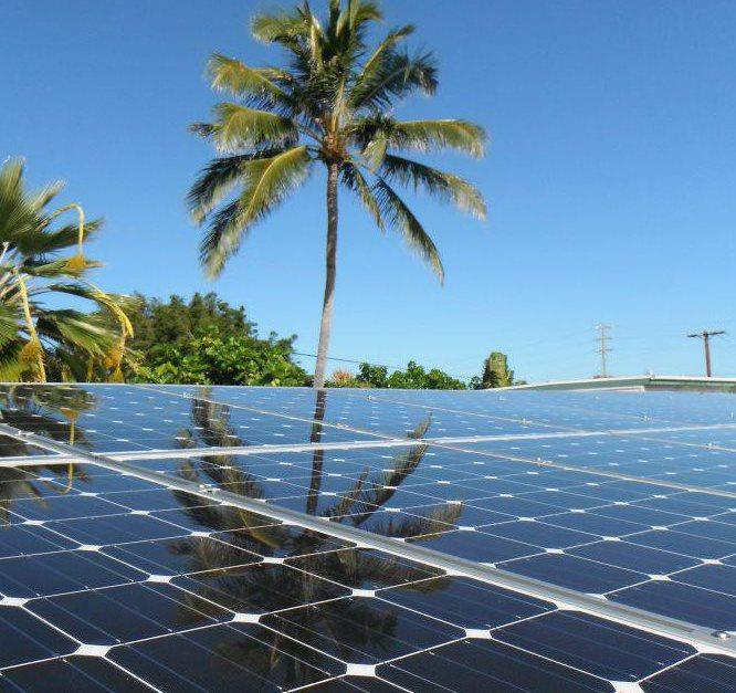 A technician installs solar panels