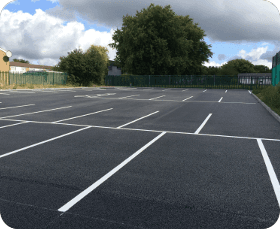 A car park with spaces marked