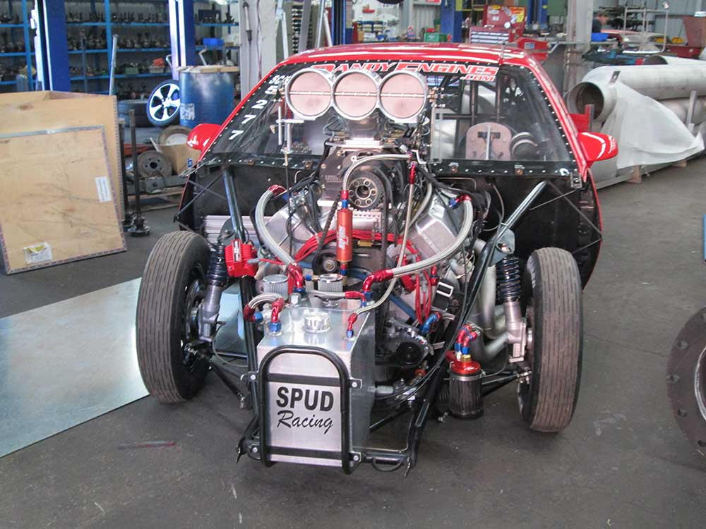 aikman engineering exposed engine of a race car