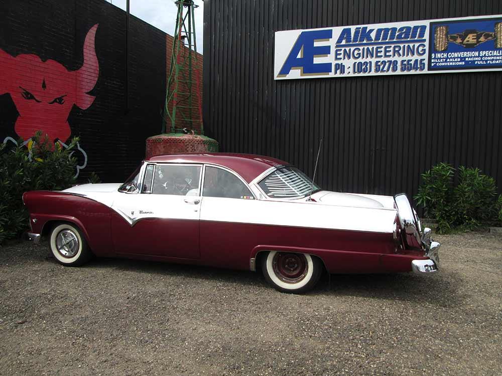 aikman engineering stylish maroon classic car with chrome