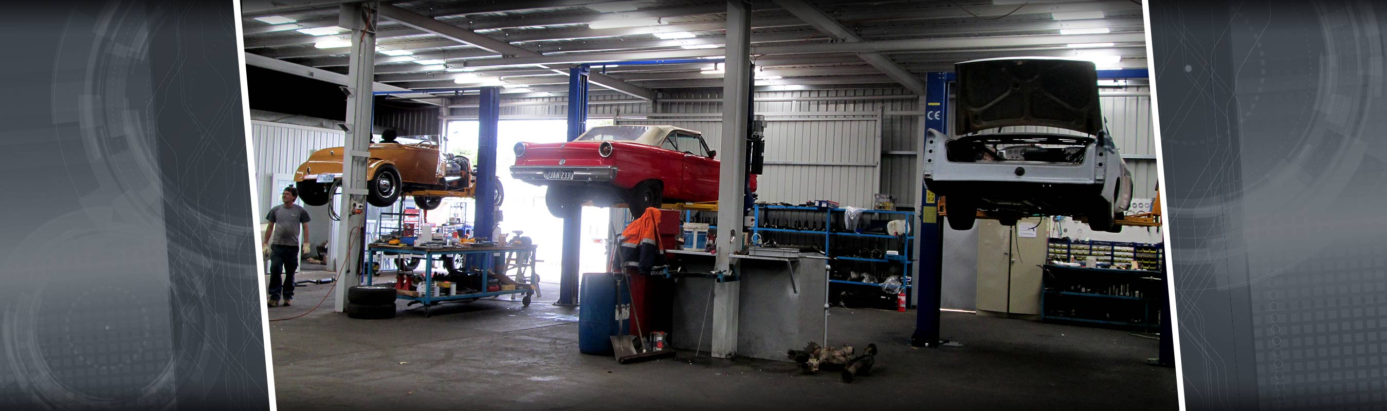 aikman engineering workshop with cars on hydraulic lift